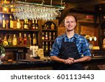 portrait of cheerful barman... | Shutterstock . vector #601113443
