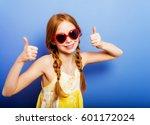 studio shot of young preteen 9... | Shutterstock . vector #601172024