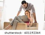 couple reading magazine... | Shutterstock . vector #601192364