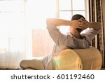 rear view of man relaxing on... | Shutterstock . vector #601192460