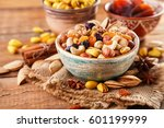 mix of nuts and dried fruits on ... | Shutterstock . vector #601199999