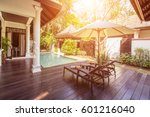 Small photo of Chaise lounge, umbrella and private swimming pool near luxury villa hotel. Sunny summer holiday