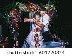 groom hugs bride from behind... | Shutterstock . vector #601220324