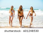 beautiful girls in the beach... | Shutterstock . vector #601248530