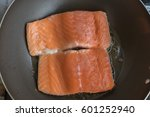 salmon fillets being cooked on... | Shutterstock . vector #601252940