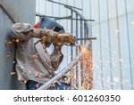 worker using electric wheel... | Shutterstock . vector #601260350
