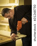 man doing some carpentry work... | Shutterstock . vector #601268750
