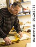 man doing some carpentry work... | Shutterstock . vector #601268756