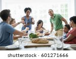 a family gathering for a meal... | Shutterstock . vector #601271666