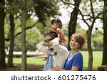 family in a park two parents... | Shutterstock . vector #601275476