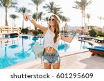 happy girl with long hair... | Shutterstock . vector #601295609