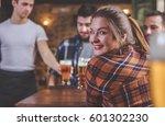 waiter serving beer at a pub.... | Shutterstock . vector #601302230