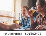 hipster woman drinking beer...   Shutterstock . vector #601302473