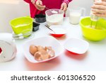 young happy family making food... | Shutterstock . vector #601306520