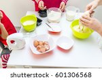 young happy family making food... | Shutterstock . vector #601306568