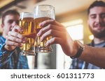 two hipsters clinking glasses... | Shutterstock . vector #601311773