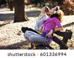 two young females sitting on... | Shutterstock . vector #601336994