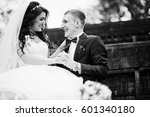 stylish groom and bride at... | Shutterstock . vector #601340180
