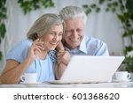 elderly couple with a laptop | Shutterstock . vector #601368620