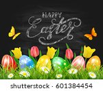 easter eggs in grass on black... | Shutterstock .eps vector #601384454