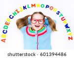 happy preschool child learning... | Shutterstock . vector #601394486