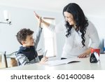a mother helping son for the... | Shutterstock . vector #601400084