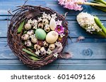 nest with easter eggs and... | Shutterstock . vector #601409126
