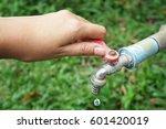 hand shut the faucet  water...   Shutterstock . vector #601420019