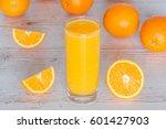 orange juice in glass at light... | Shutterstock . vector #601427903