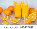 orange juice in glasses at... | Shutterstock . vector #601439489
