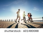young people running along a...   Shutterstock . vector #601480088