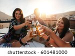 friends toasting drinks on a... | Shutterstock . vector #601481000