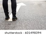 boots on a tarmac road with... | Shutterstock . vector #601498394