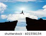 man jump through the gap... | Shutterstock . vector #601558154