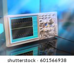 Small photo of Modern electronic oscilloscope on abstract background