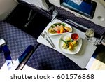 served lunch in aircraft | Shutterstock . vector #601576868