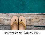 beige flip flop sandals on the... | Shutterstock . vector #601594490