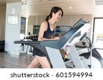 woman running on treadmill in... | Shutterstock . vector #601594994