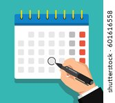 calendar on the wall and hand... | Shutterstock .eps vector #601616558