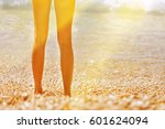 female feet emerging from the... | Shutterstock . vector #601624094