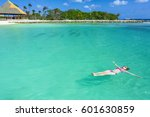 woman floating on a back in the ... | Shutterstock . vector #601630859