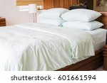 light green themed bed sheets... | Shutterstock . vector #601661594