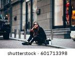 young stylish girl  passing by... | Shutterstock . vector #601713398