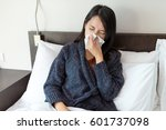 woman feeling sick and lying on ... | Shutterstock . vector #601737098