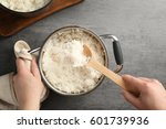 woman mixing cooked rice with... | Shutterstock . vector #601739936