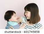 mother and her baby against... | Shutterstock . vector #601745858