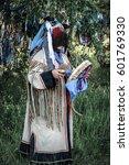 shaman performs a ritual | Shutterstock . vector #601769330