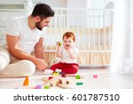 happy father playing with... | Shutterstock . vector #601787510