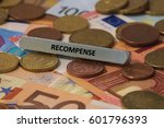 Small photo of recompense - the word was printed on a metal bar. the metal bar was placed on several banknotes