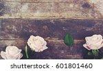 Stock photo flower header pink roses on old wooden vintage desk 601801460